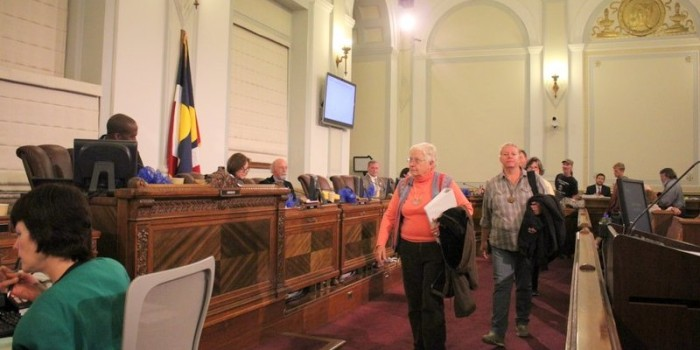 Opponents to Urban Camping Ban Interrupt Council Meeting to Deliver Signatures